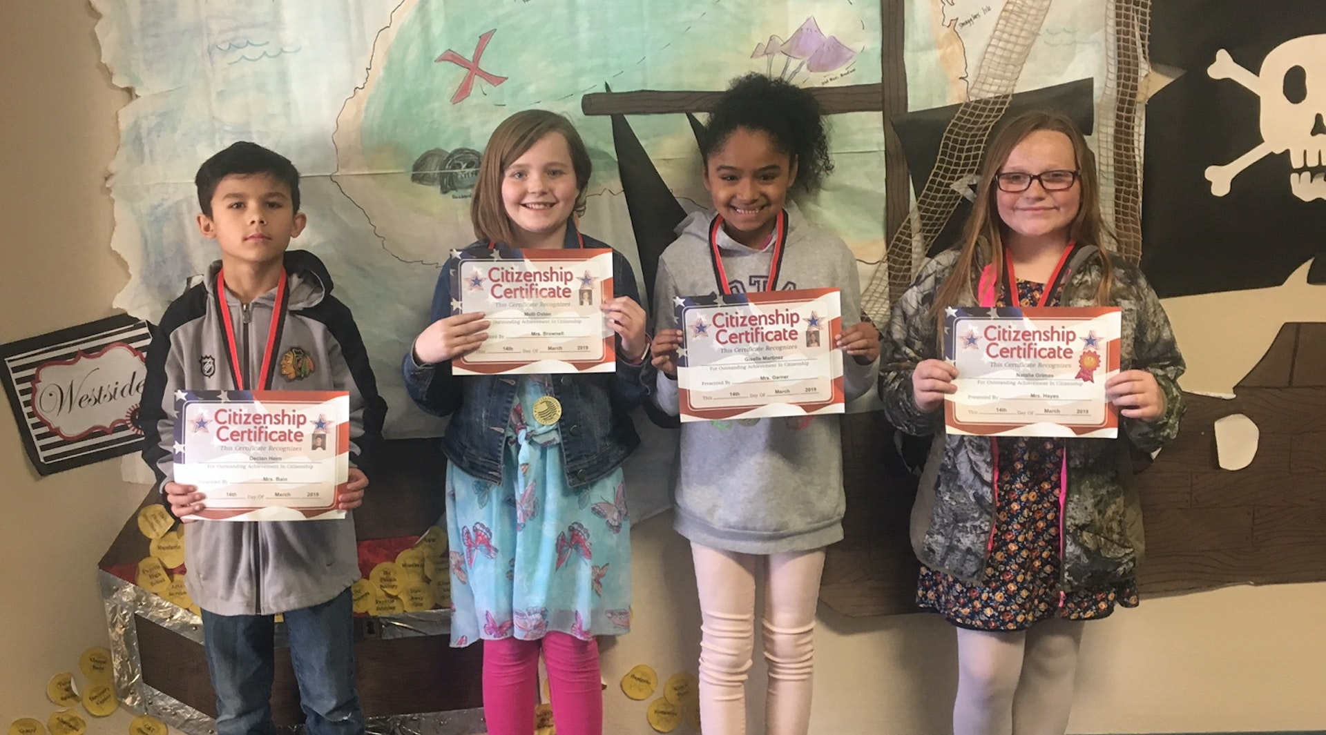 5th Grade children holding citizenship award
