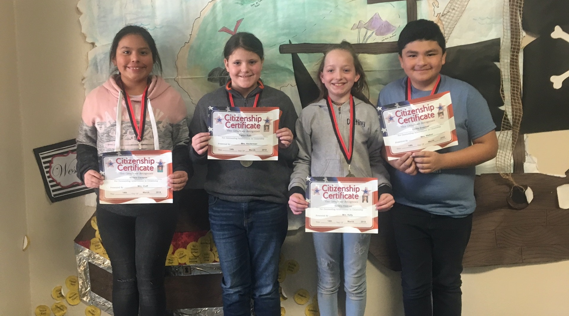 4th Grade children holding citizenship awards