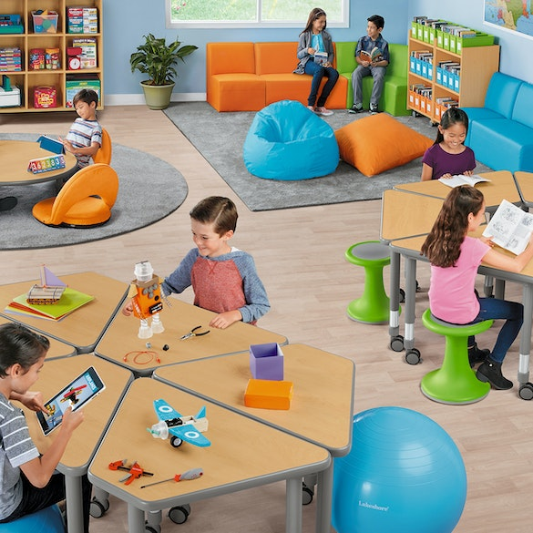 Students sitting on various flexible seating furniture