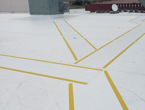 white roof with yellow path markers