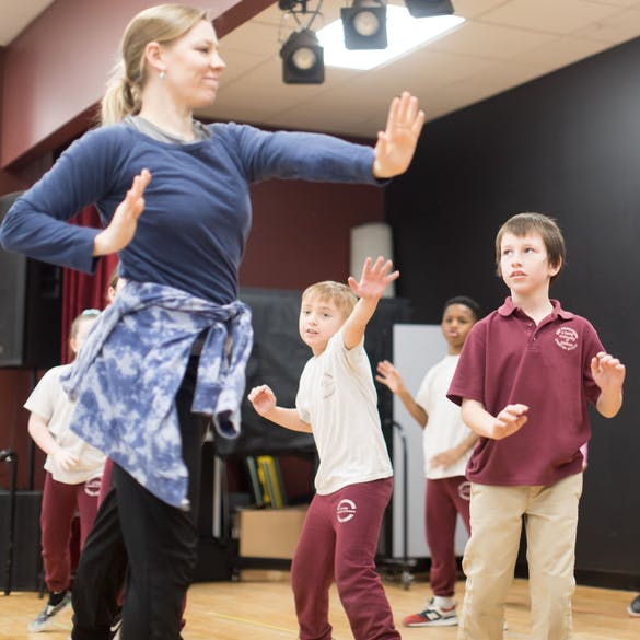 Teacher instructing students on martial arts moves