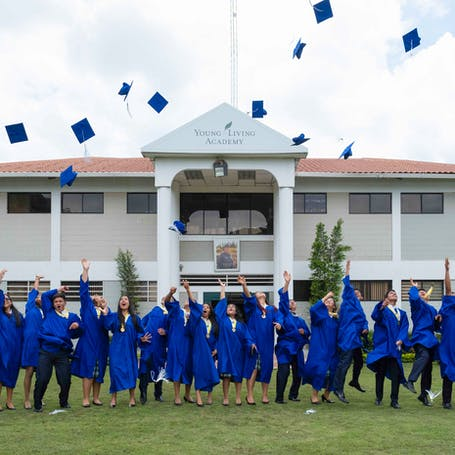 Young Living Foundation - Our Story - Young living Academy graduates toss their caps