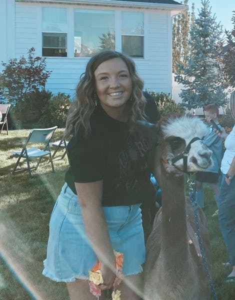 woman with an alpaca